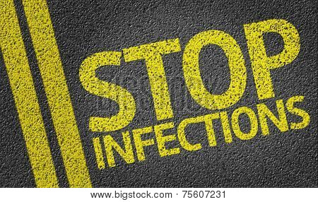 Stop Infections written on the road poster
