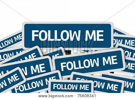 Follow Me written on multiple blue road sign