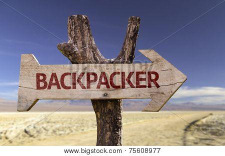 Backpacker wooden sign isolated on desert background