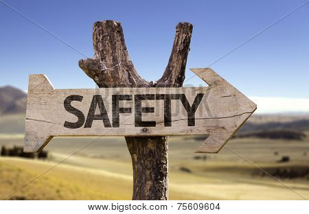 Safety wooden sign with a desert background