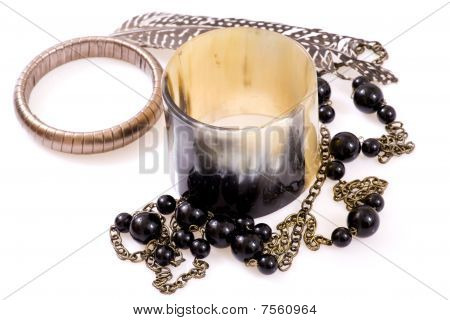 Jewelry, Perl, Feather And Bracelet In Composition