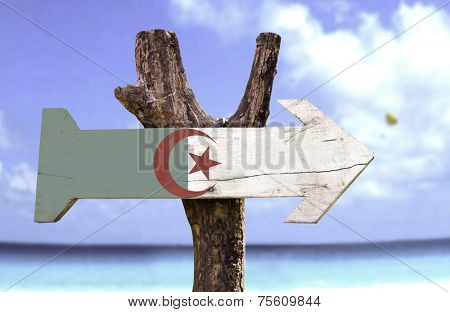 Algeria wooden sign with a beach on background
