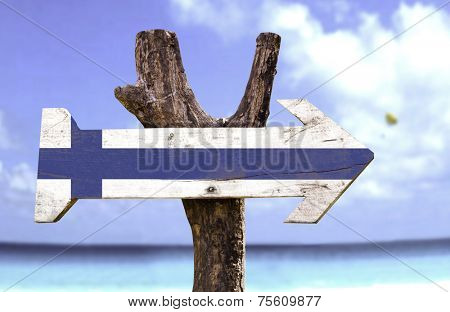 Finland wooden sign with a beach on background  poster