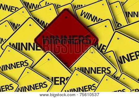 Winners written on multiple road sign
