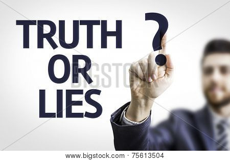 Business man pointing to transparent board with text: Truth or Lies?