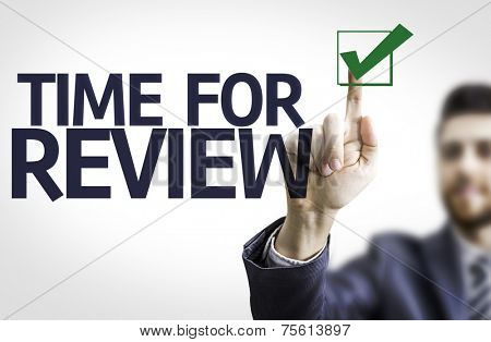 Business man pointing to transparent board with text: Time For Review