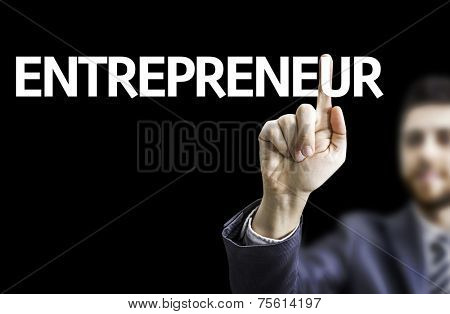 Business man pointing to black board with text: Entrepreneur