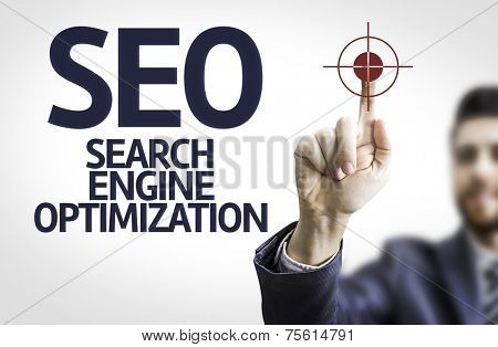 Business man pointing to transparent board with text: SEO