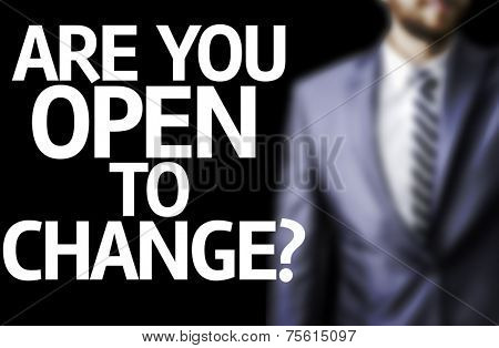 Are you Open to Change? written on a board with a business man on background