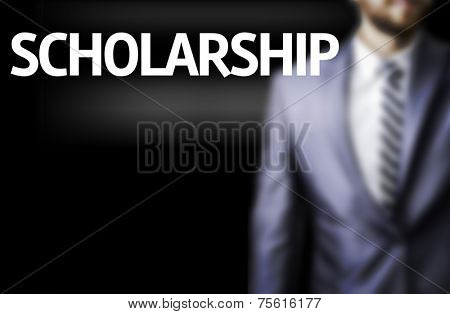 Scholarship written on a board with a business man on background