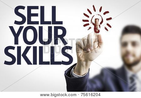 Business man pointing to transparent board with text: Sell Your Skills