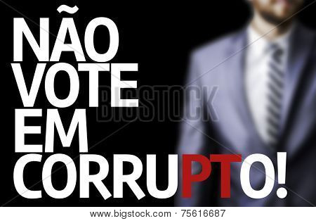 Don't Vote for Corruption (In portuguese) written on a board with a business man on background