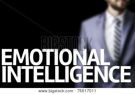 Emotional Intelligence written on a board with a business man on background