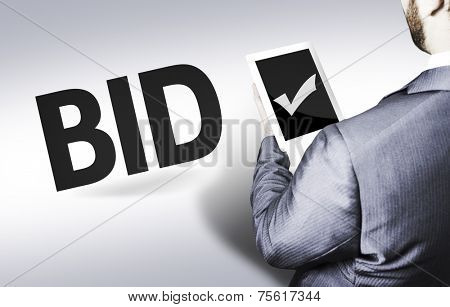 Business man with the text Bid in a concept image