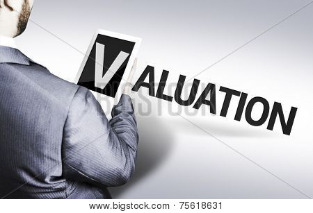 Business man with the text Valuation in a concept image