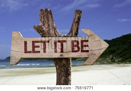 Let It Be wooden sign with a beach on background