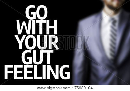 Business man with the text Go With your Gut Feeling in a concept image