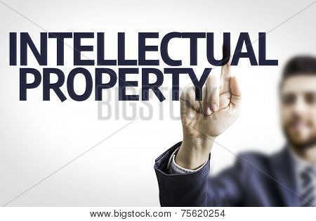 Business man pointing to transparent board with text: Intellectual Property