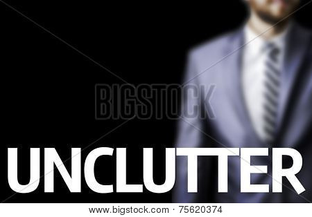 Business man with the text Unclutter in a concept image