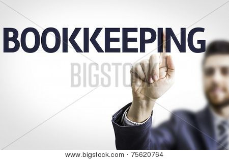 Business man pointing to transparent board with text: Bookkeeping