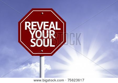 Reveal your Soul written on red road sign with sky background poster
