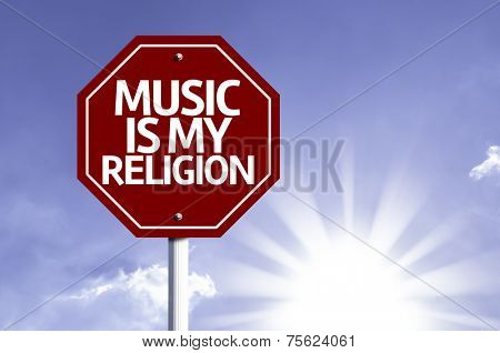Music Is My Religion written on red road sign with a sky on background