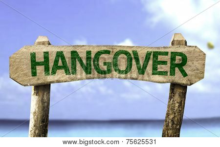 Hangover wooden sign with a beach on background