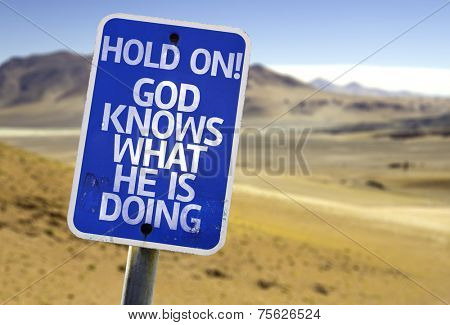 Hold On! God Knows What He is Doing sign with a desert background