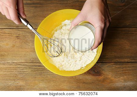 Preparing dough, mixing ingredients
