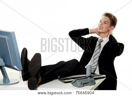 a successful young businessman at desk in office