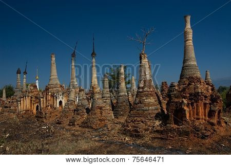 Ancient Buddhist Temple In The Jumgle At Inn Taing On Inle Lake In Myanmar.