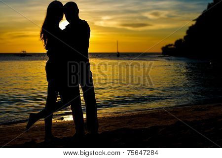 young loving couple on wedding day on tropical beach and sunset sea background