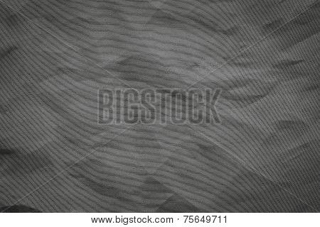 the abstract textured background from crumpled mesh with small cells synthetic fabric of black color poster
