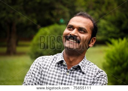 Happy Smiling Day Dreaming Indian Executive Or Employee