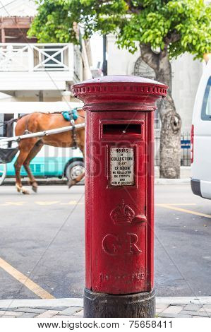 Oldstyle Red Mail Box On Street In Bahamas