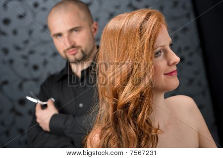 Professional Hairdresser With Fashion Model At Luxury Salon