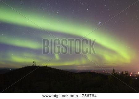 Aurora Swirling Over Town
