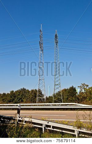 electrical pylon under blue sky