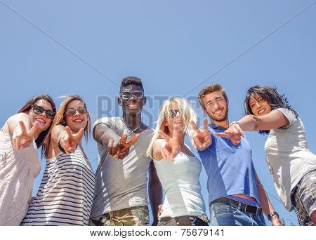 Friends Outdoors With V Hand Sign