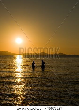 A couple in love at sunset Naxos Greece.