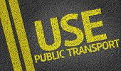 Use Public Transport written on the road poster