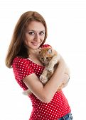 The happy young woman with a small amusing kitten on a white background. poster