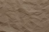 the abstract textured background from crumpled mesh with small cells synthetic fabric of brown color poster