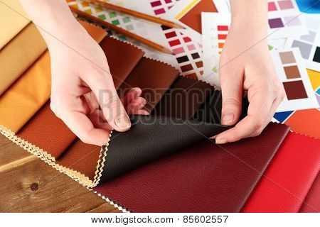 Woman working with scraps of colored tissue and palette close up poster