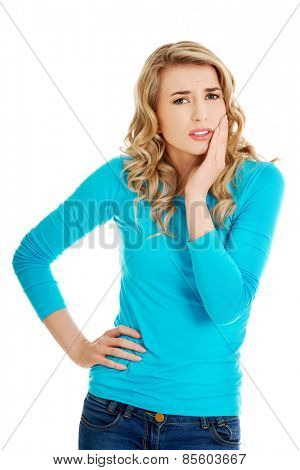Beautiful woman having strong toothache.