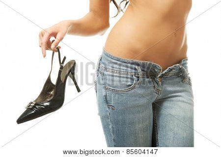 Woman hand holding black high heels shoe.