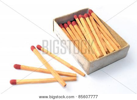 The box of matches and the other 4 matches outside the box