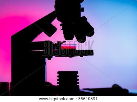 Silhouette of a laboratory microscope