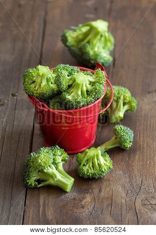 Green Broccoli In Red Bucket