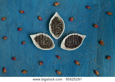 Tea Leaves On A Plate With Rose Buds And Lavender Seeds